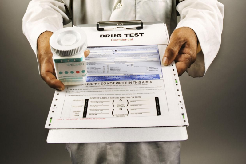 Doctor handing drug test forms